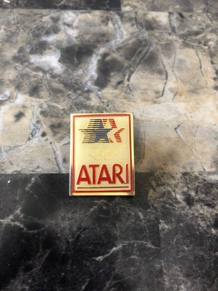 Vintage atari olympic pin 1980