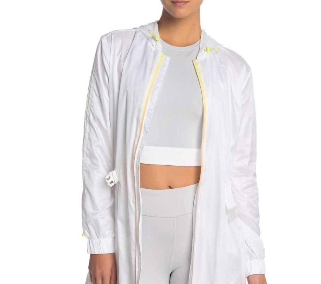Selena Gomez S Puma white yellow jacket