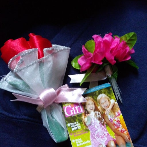 American girl booklet and flowers.