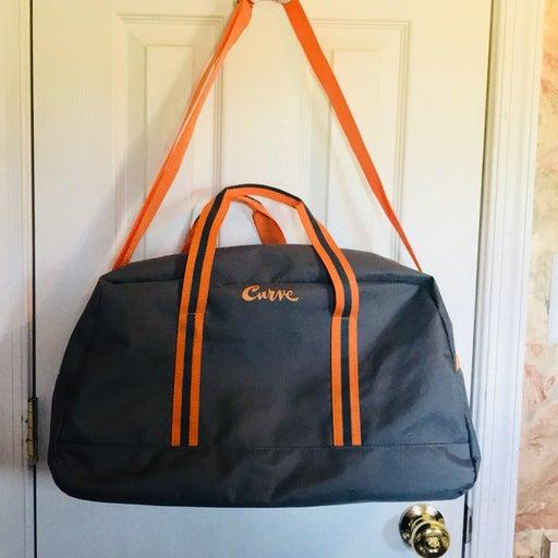 NWOT Curve Duffel Bag