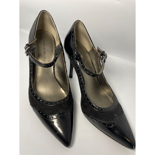 Bandolino pointed toe wingtip pumps / heels size 7. Black suede and patent.