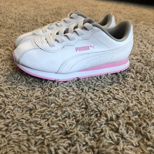 Girls pink/white Puma sneakers