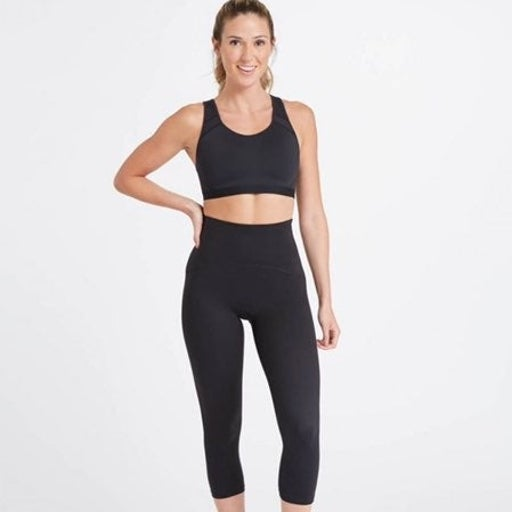 Spanx booty boost active cropped leggings black small Hidden back waist pocket,