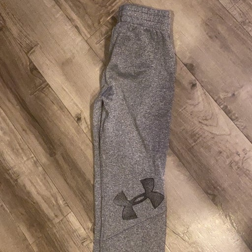2 pairs of Under Armour pants size 4 & 1 nike dri fir hoodie size 3/4