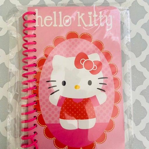 Un opened Hello Kitty notebook