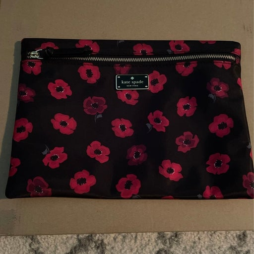 like New Kate Spade floral clutch