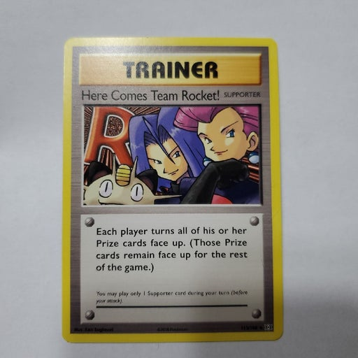 Trainer card ( here comes team rocket)