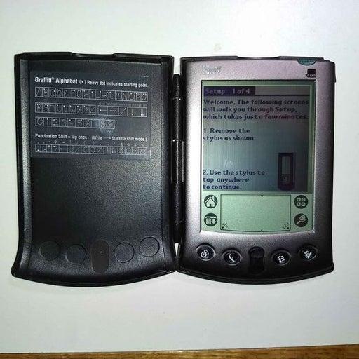 3Com Palm V PDA with hard case and cradl
