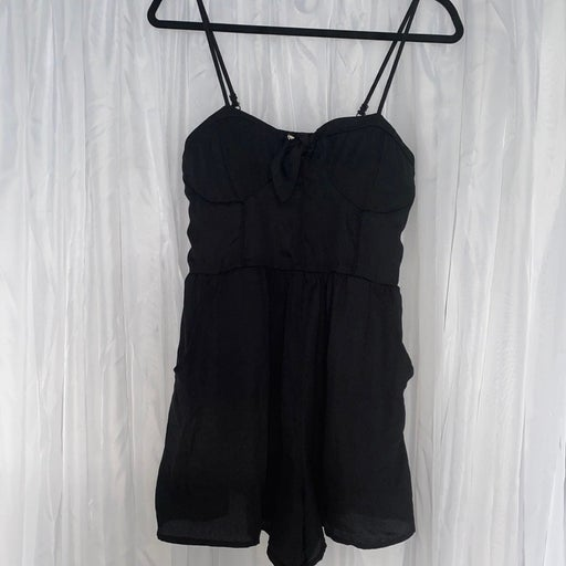 Black romper with bow in front and pocke