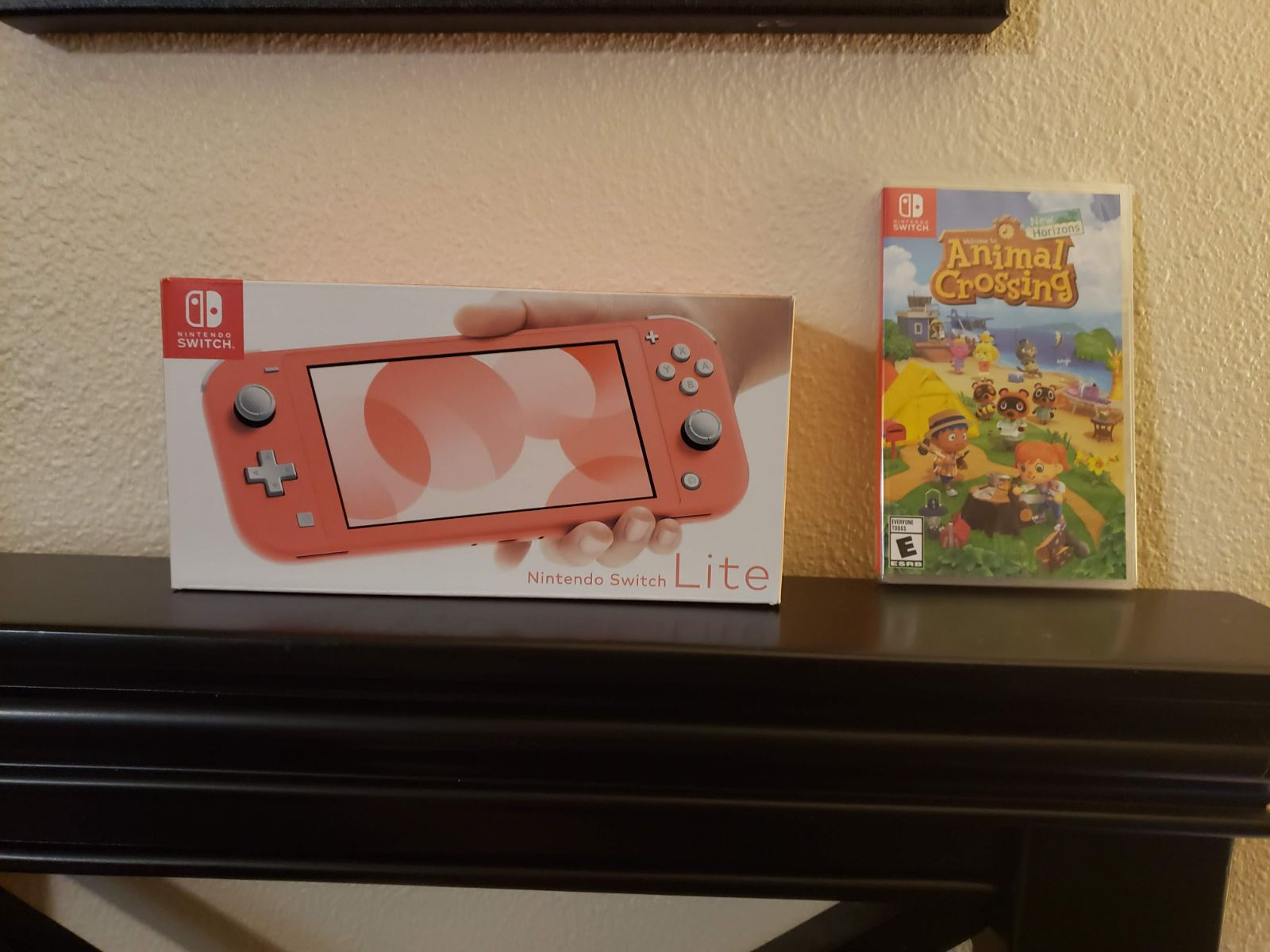 Nintendo Switch Lite Coral with Animal C